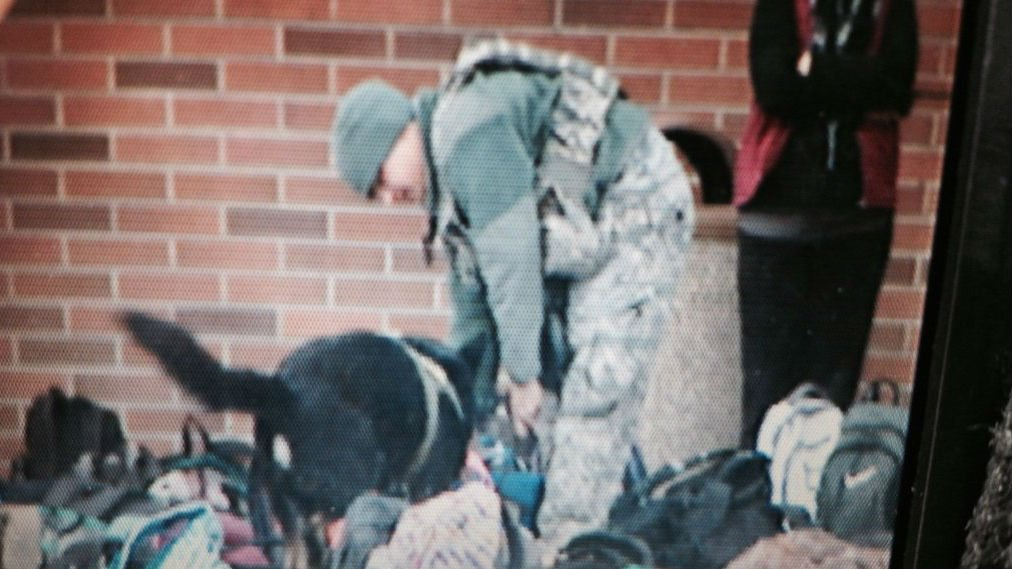 K9 from Fairchild have just arrived and are searching students' bags for signs of explosives.