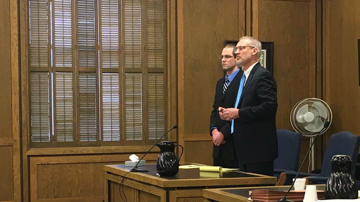 Murry showed no reaction as he was sentenced to three life terms in prison