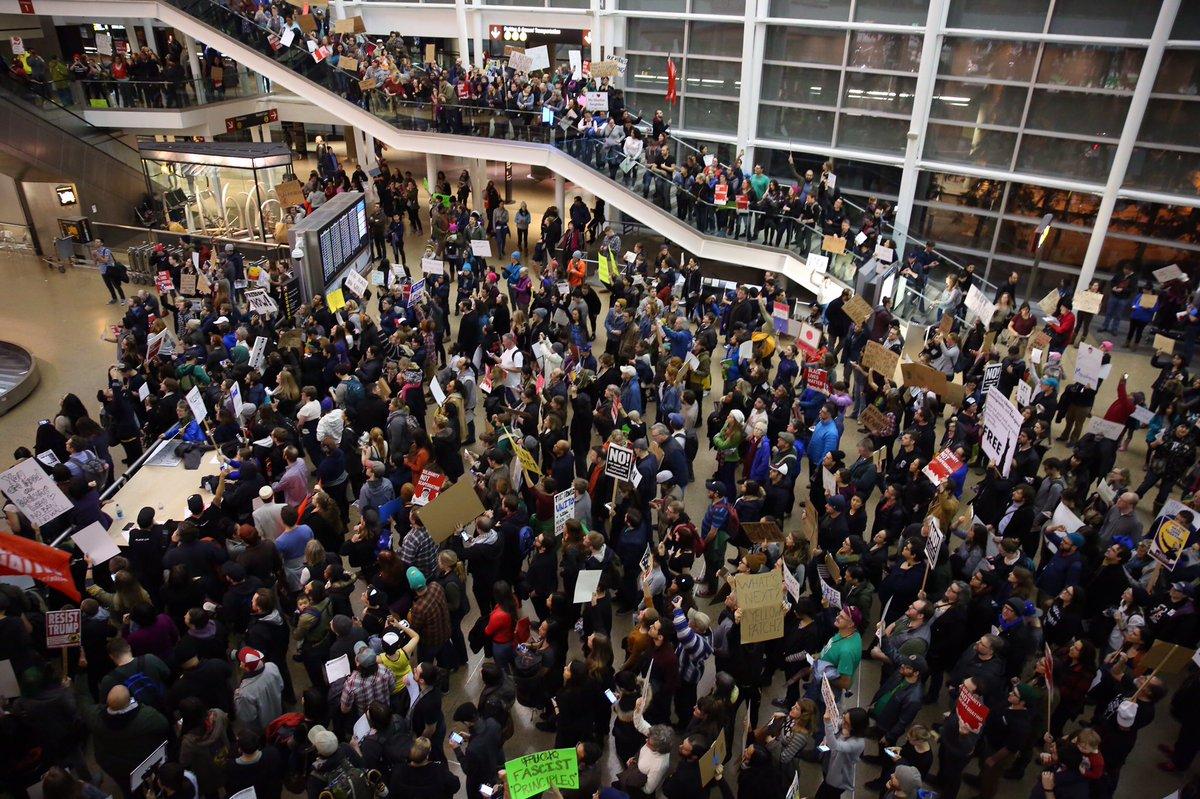 Protesters at SeaTac airport Saturday. Photo: Josh Trujillo/Twitter