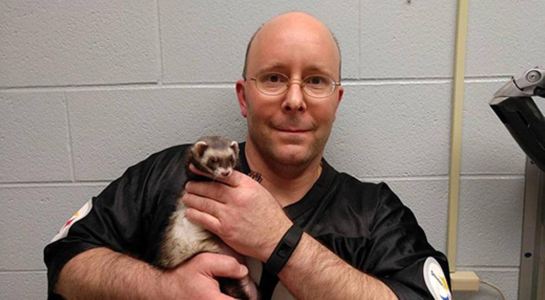 Owner Carl Hobi and his ferret Zelda before her heart pacemaker implant surgery at Kansas State University's Veterinary Health Center.  (PHOTO: KSU)