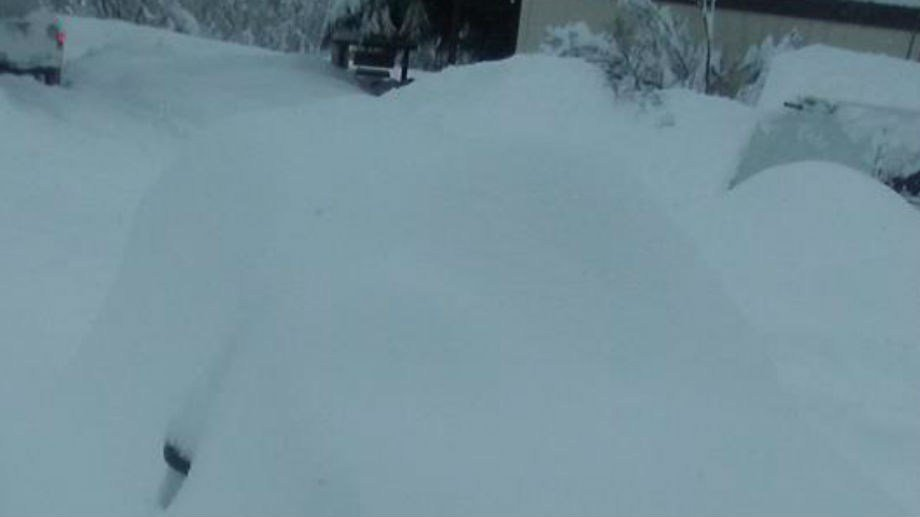 Photo of a buried car in Bonners Ferry from KHQ Facebook friend ?Juanita Miller?