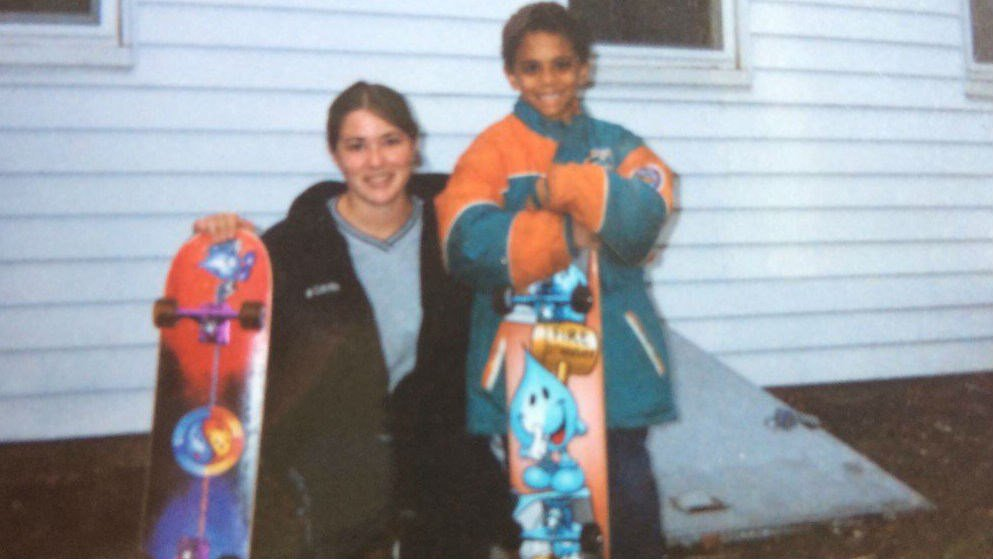 The skateboard the woman is holding is mising