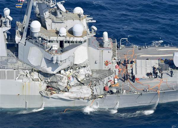 Navy crew missing, skipper hurt after collision off Japan
