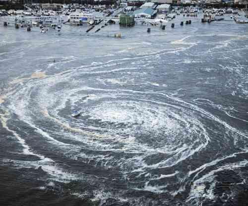 Tsunami swirls near a port in Oarai, Ibaraki prefecture