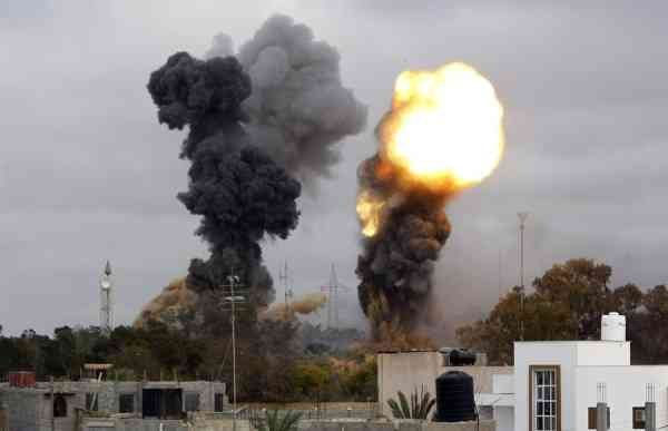 Smoke billows as several explosions were reported in the tightly-guarded residence of leader Moammar Gadhafi and military targets in the suburb of Tajura on March 29