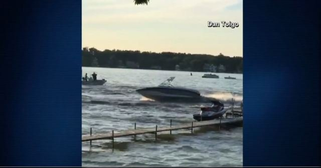 Runaway boat throws passengers before heroic officer jumps in to stop it