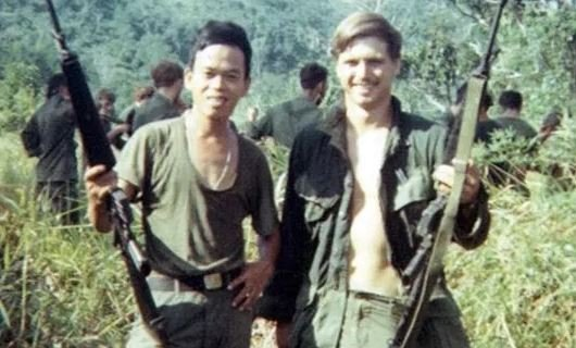This 1969 photo shows James McCloughan, right, with a platoon interpreter in Nui Yon Hill in Vietnam.