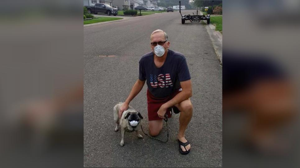 John Gomez and his dog Rocko (safely) brave Spokane's smoke