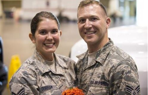 Instead of a poofy white dress and their picture perfect beach wedding, Lauren Durham and Michael Davisgot got married in their Air National Guard fatigues so they could be ready to help with Hurricane Irma relief.