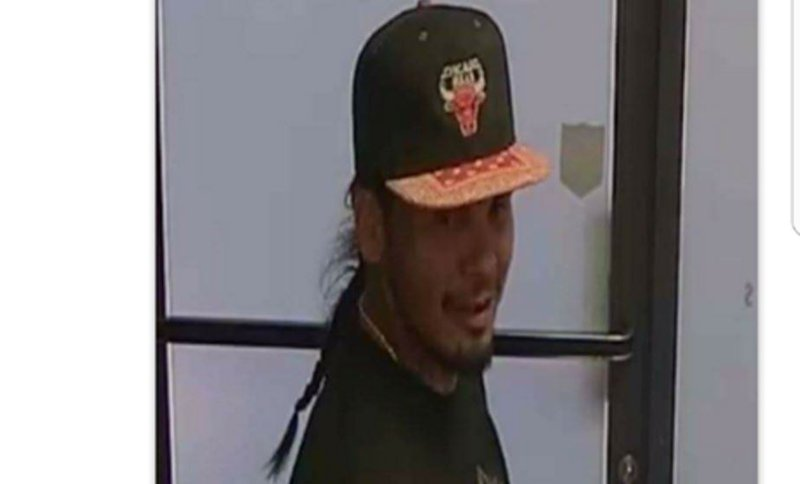 Police are looking for this man who they saw shot at an employee who was  sitting
