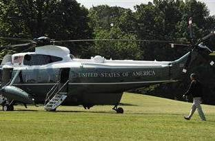 President Barack Obama walks across the White House's South Lawn to depart for a visit to Camp David on Saturday