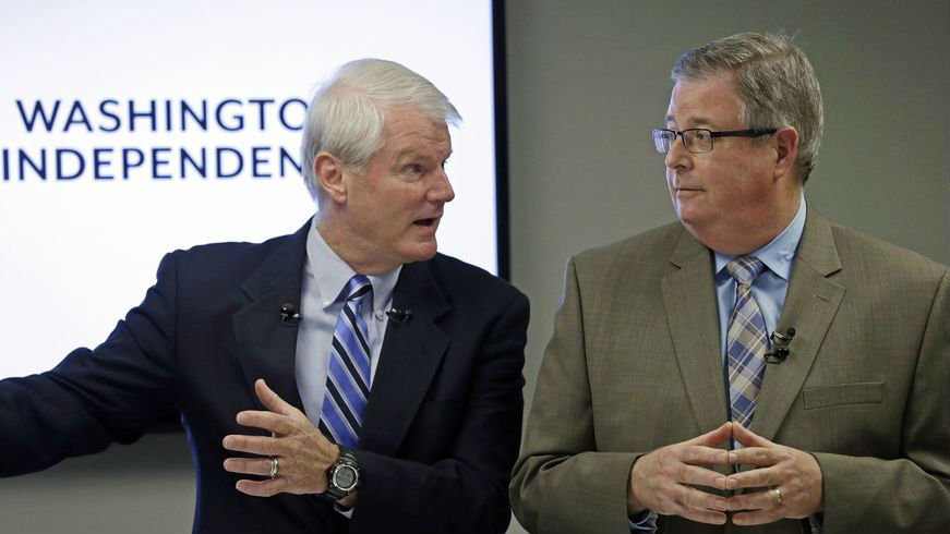 Former Democratic Congressman, Brian Baird, left, and former Republican State Representative Chris Vance speak at a news conference Thursday. (AP Photo/Elaine Thompson)