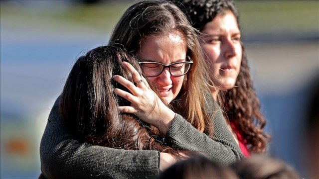 Mother hugs her daughter following deadly Florida shooting