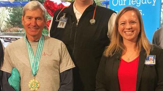 Runner reunites with nurse who helped save his life at Portland Marathon