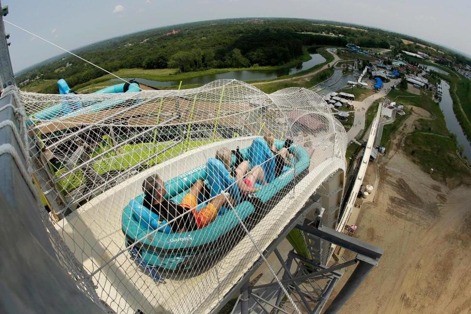 "In this July 9, 2014, file photo, riders go down the water slide called ""Verruckt"" at Schlitterbahn Waterpark in Kansas City. (AP Photo/Charlie Riedel, File)"