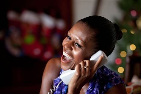 First Lady Michelle Obama talks to a child Saturday as part of the annual NORAD Tracks Santa program. Mrs. Obama answered the phone calls from Kailua, Hawaii.