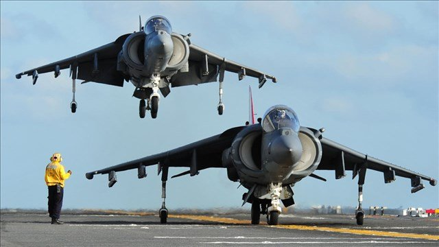 A pair of AV-8B Harriers aboard the amphibious assault ship USS Makin Island, Photo Date: February 2011 Courtesy: John Lill / U.S. Navy