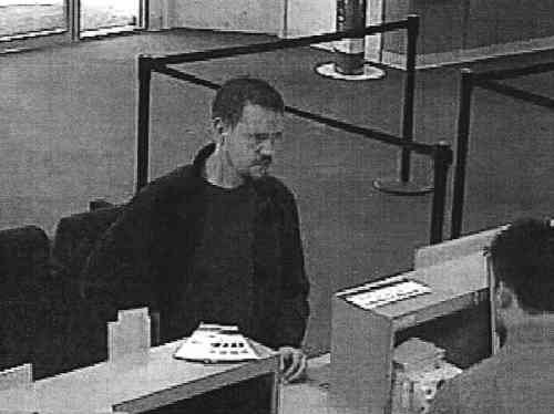 Josh Powell withdrawing cash at a bank the day before he killed himself and his two sons (Courtesy KOMO TV)
