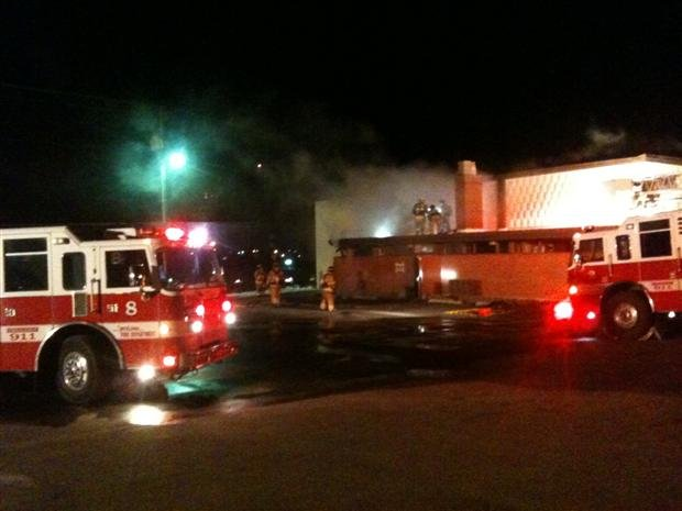 Firefighters attack flames at a commercial building near SCC (Photo From KHQ Reporter Patrick Erickson)