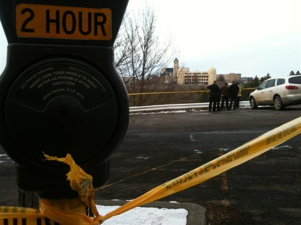 Officers block off the scene near The Spokane Club to investigate a body found on the south bank of the river. (Photo from KHQ)
