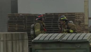 Firefighters on scene of a warehouse fire Friday afternoon