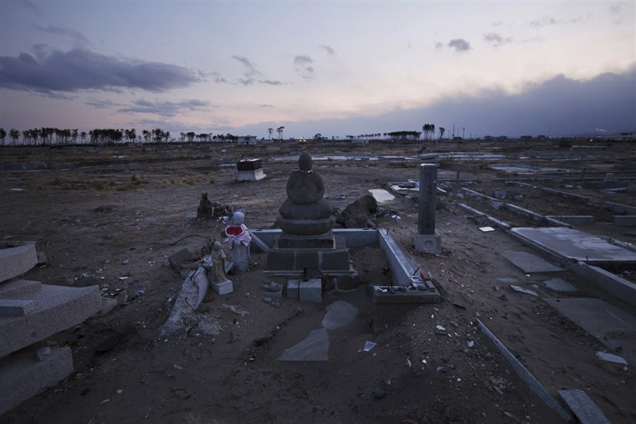 Buddhist tombstones stand in the empty land which was once a crowded residential area in Sendai, Feb 18, 2012. (PHOTO FROM MSNBC)