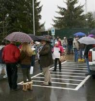 A group stands outside CDA City Hall Wednesday morning with recall petitions (PHOTO KHQ)