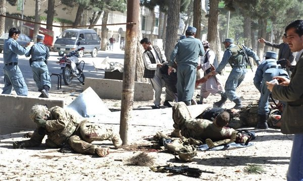 Wounded U.S. soldiers lie on the ground at the scene of a suicide attack Wednesday in Maimanah, the capital of Faryab province north of Kabul, Afghanistan, courtesy MSNBC