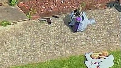 Gun on sidewalk where suspect shot himself