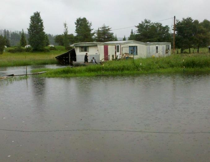 Photo from Bonners Ferry, Idaho of a trailer surrounded by water