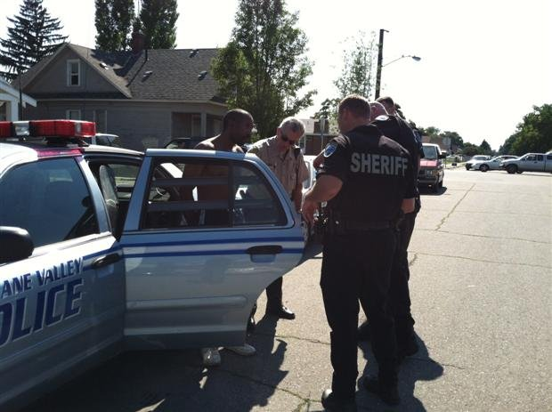 Police detain one individual at Nevada and Gordon Tuesday afternoon. The man is suspected in being involved in a knife fight in Spokane Valley