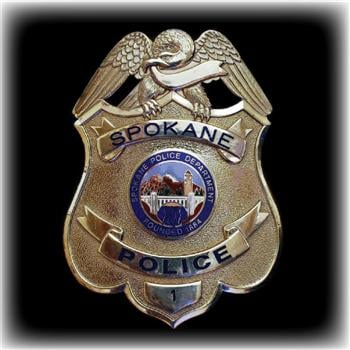 Spokane police investigating theft from non profit for Department of motor vehicles spokane valley