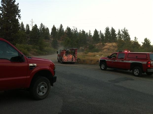 Firefighters from Spokane and DNR working on multiple brush fires on Beacon Hill