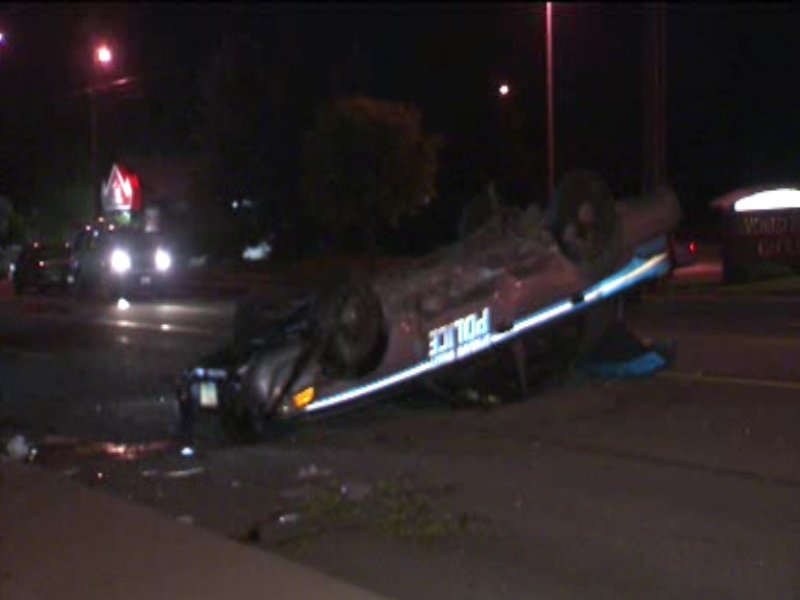 A log deliberately placed in the road in Spokane Valley caused a patrol car to flip while responding to a call