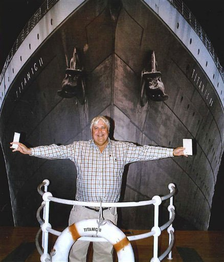 Australian billionaire Clive Palmer poses in front of an artist impression of the Titanic ll at MGM Studios in Los Angeles, Ca. (AP Photo/Crook Publicity)