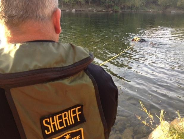 © Photo of Deputy Bloomer looking for gun in the Spokane River