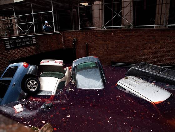 Cars float in a flooded basement Tuesday morning in New York's Financial District.