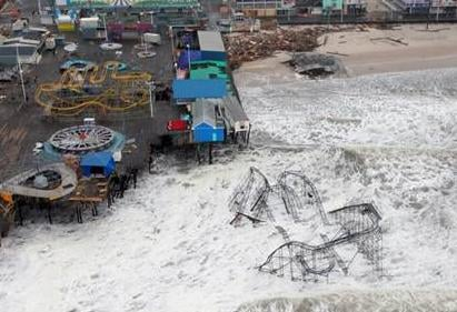 Damage to a pier and amusement park on the New Jersey coast. (Master Sgt. Mark Olsen / US Air Force via EPA)