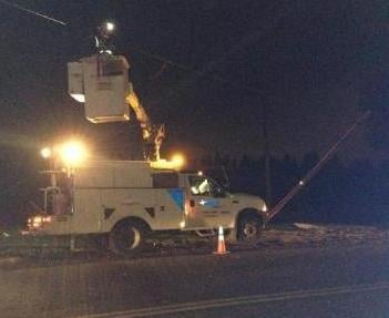 © Photo of Avista crews working on fixing the downed power pole