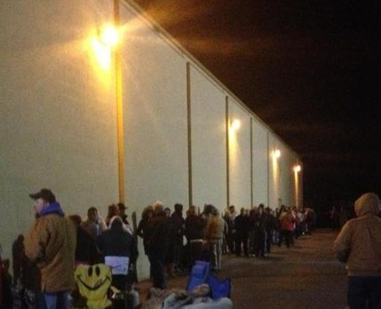 © Customers stand in line Thursday morning at the K-Mart in Spokane Valley