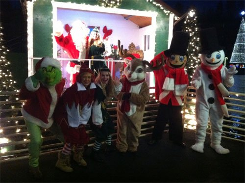 Santa and his helpers pose for a picture on KHQ Local News Today (Photo: KHQ)