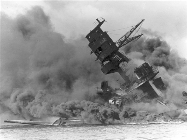 The USS Arizona perishes at Pearl Harbor, Hawaii, 1941, Photo Credit: Courtesy of US Navy