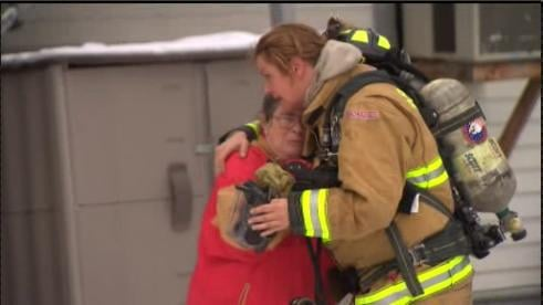 Firefighter Comforts Resident