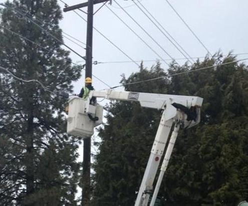 Photo: Steve with Avista Utilities works on fixing a power line Monday after a tree fell on it. The picture is from 42nd St. on Spokane's South Hill.