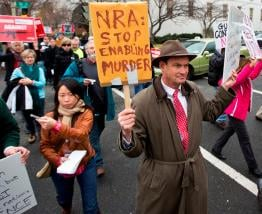 Patrick Hand, center, joins a march to the National Rifle Association headquarters on Capitol Hill in Washington Monday, Dec. 17, 2012.(AP Photo/Manuel Balce Ceneta) (School Shooting Gun Control)