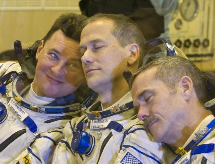 Associated Press/ Shamil Zhumatov, pool - The International Space Station (ISS) crew members, from left: Russian cosmonaut Roman Romanenko, U.S. astronaut Thomas Marshburn and Canadian astronaut Chris Hadfield