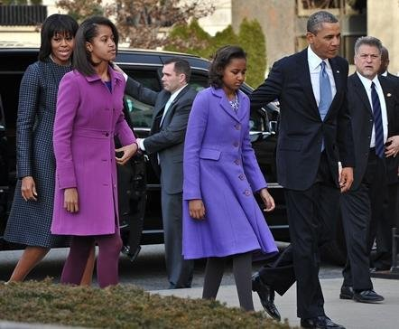 President Barack Obama, First Lady Michelle Obama and their daughters Sasha and Malia arrive at St. John's Church on Monday morning.