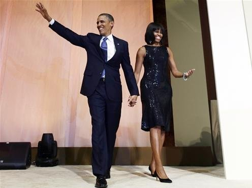 President Barack Obama and first lady Michelle Obama arrive to speak to supporters and donors at an inaugural reception for the 57th Presidential Inauguration at The National Building Museum in Washington on Sunday, Jan. 20, 2013.