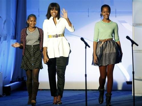 The first lady takes the stage with daughters Sasha and Malia at the Kids Inaugural concert for children and military families on January 19.