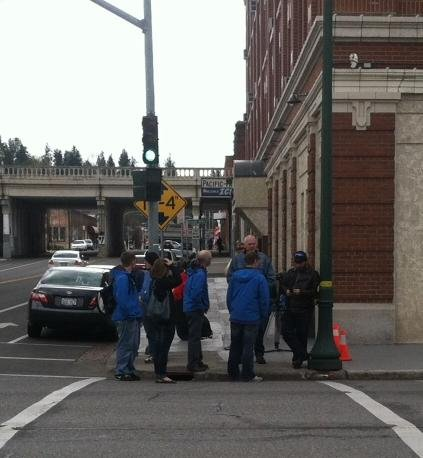 Photo of KHQ employees standing outside of the building after being evacuated